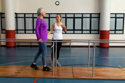 Who should consider visiting a physical therapist for a fall risk assessment?